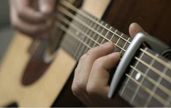 Why Should You Use an Acoustic Guitar Capo Instead of Manually Tuning the Guitar Strings?